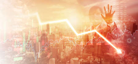 Businessman touching a graph falling and analysis corona virus economic impact. Crisis of financial conditions in the global stock exchanges. Stocks fall. Effects of outbreak and pandemic covid-19