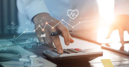 Healthcare business graph data and growth, Doctor use calculator and calculate healthcare costs and analyzing medical report on tablet. 版權商用圖片 - 161884104