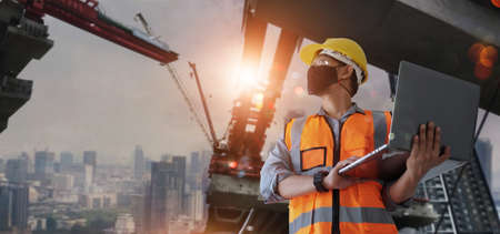 Architect, civil engineer holding laptop inspect and oversee infrastructure progress and security of city construction project. Industrial innovative technology and global construction solution concept 版權商用圖片 - 162310096