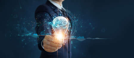 Businessman holding light bulb and brain inside, Idea and imagination, Creative and inspiration, Science innovation with network connection, Solution analysis and development, Innovative technology. 版權商用圖片 - 161884110