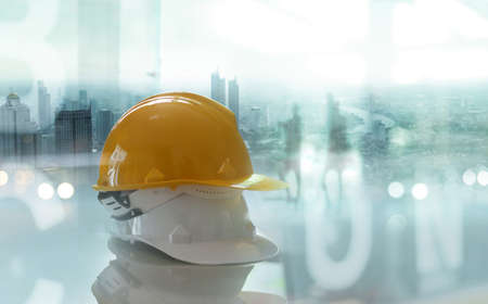 Safety helmets, Construction worker equipment on table in construction site and city background, Safety first.