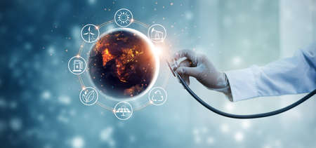 Earth at night being checked by a doctor with a stethoscope with energy resources icon. Abstract of environment. Earth day. Energy saving concept.