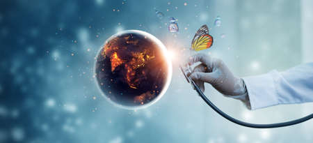Earth at night being with butterfly checked by a doctor with a stethoscope. Environment and pollution. Save the world. Earth day. Energy saving concept. 版權商用圖片 - 161884137