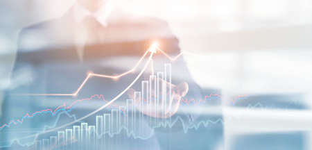 Businessman pointing at successful growth graph indicators. Key elements to achieve sustainable development goals planning to increase profit for business in future.