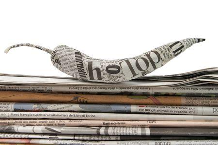 newspaper pepper on a stack of newspaper