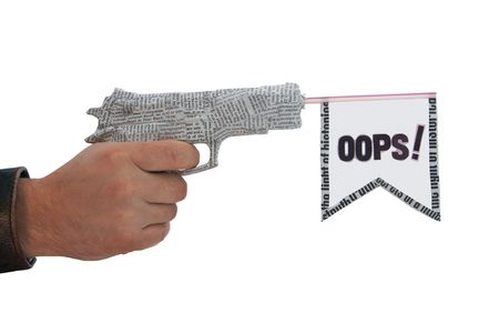 male hand with shoting newspaper pistol and flag on white background. oops fake photo