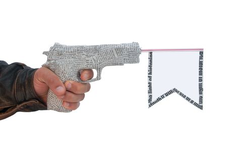 left male hand with fire a shot newspaper pistol and flag isolated on white background. fake photo