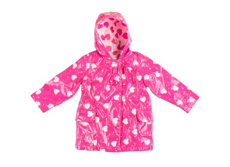 Childrens stylish fashionable lacquered pink jacket with white hearts for the little girl, windbreaker with hood,  buttoned raincoat with pockets isolated on a white background