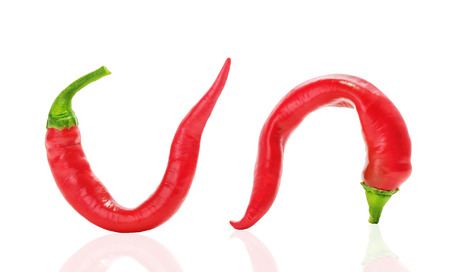 sex education: Two red hot chili curved peppers similar to a mans penis long or large size, the concept of potency, mens Health Stock Photo