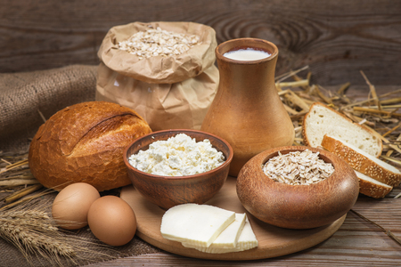 milk products: Farmers rustic natural organic foods, balanced diet, cooking, culinary, food concept, dairy products, bread,  oatmeal, cheese, cottage cheese, eggs, milk on the old wooden background
