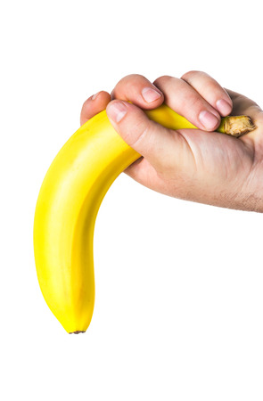 mans hand holding a banana Stock Photo