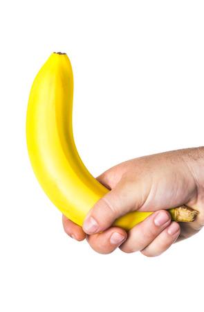 abstrakcje: mans hand holding a banana Zdjęcie Seryjne