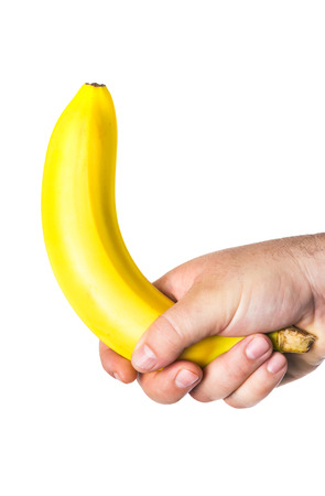 potency: mans hand holding a banana Stock Photo