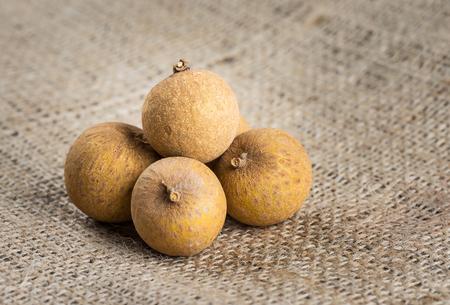 flesh colour: sweet organic longan, asian fruit on sacking Stock Photo