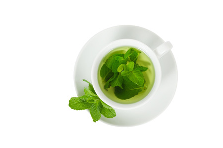 Mint tea with fresh mint in a white cup, top view, closeup, isolated on white Imagens - 45961009