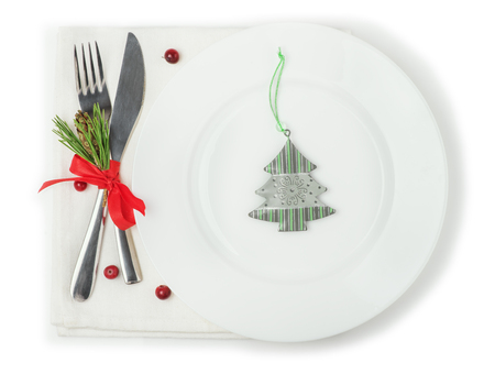 plate: Plate, fork and knife with Christmas decor, top view, isolated on white background
