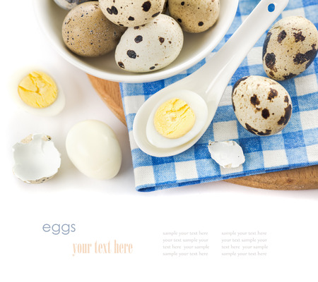 raw and cooked quail eggs in a plate, shell, top view close-up on a white background Imagens