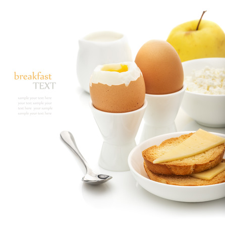 cottage cheese: Healthy delicious breakfast, soft-boiled eggs in the stands, toast with cheese, cottage cheese, apple, cream on a white background, the concept of a balanced diet, diet