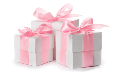 Gift white box with pink satin ribbon isolated on white background, congratulations on Women's Day, mum's day, Valentine's day, happy birthday 免版税图像
