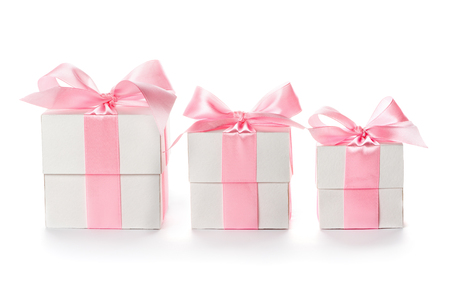 Gift  boxes with pink satin ribbon isolated on white background, congratulations on Women's Day, mum's day, Valentine's day, happy birthday Foto de archivo