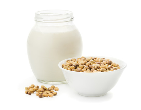 soymilk: Soy milk in a glass jar and soybeans Isolated on white background Stock Photo