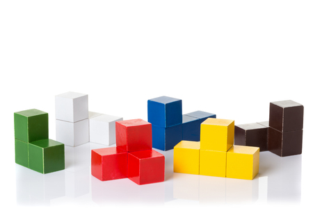 montessori: Multi colored wooden blocks, logic puzzle Montessori material isolated on white background, space for text