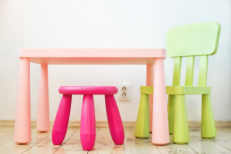 comfortable chair: Modern and comfortable soft set of childrens furniture, a table, a chair and a stool in the apartment