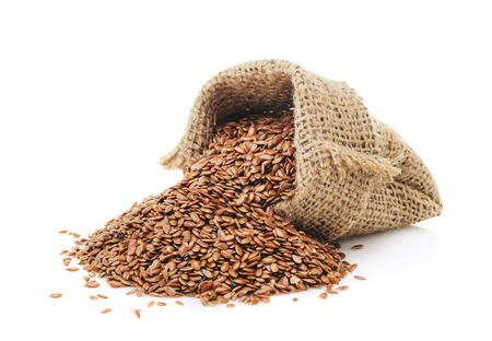 organic flax seed: Flax seeds in a bag isolated on a white background closeup