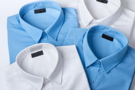 Set of blue and white mans shirt closeup Foto de archivo