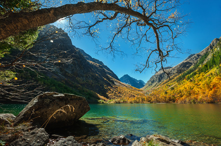 Scenic autumn landscape in the Caucasus mountains, Baduk glacial lake, mountains, rocks
