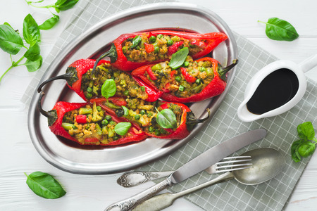 Vegan stuffed pepper with soy meat and vegetables on the table