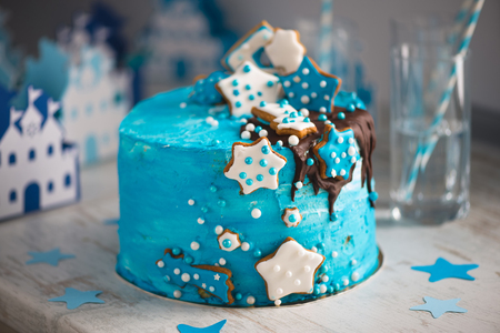 Blue festive cake with cookies