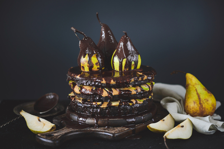 Chocolate cake with peanut cream and pears
