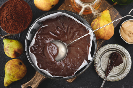 chocolate vegan Dough for cake in a baking dish , flour, sugar, cocoa powder Imagens