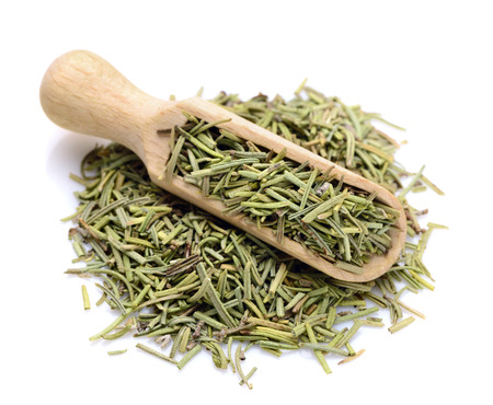 Dried Rosemary in a scoop for spices Imagens - 76821103