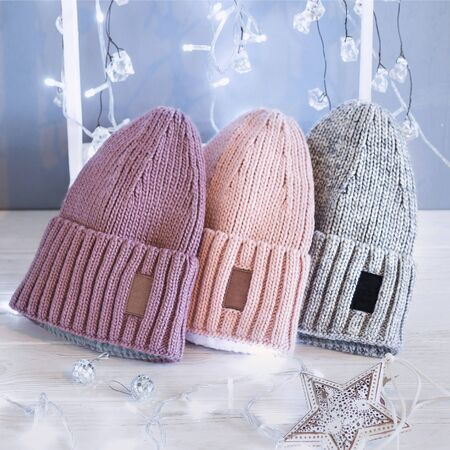 Knitted hats, close-up on a white background Imagens