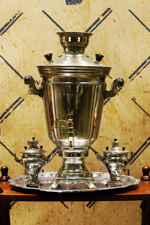 boiling tube: The samovar is a device for boiling water and cooking tea. Initially the water was warmed by the inner firebox, which represents a high tube filled with wood coals Stock Photo