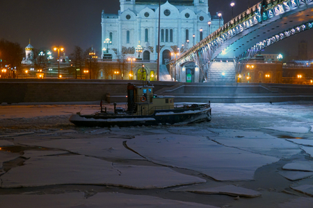 michigan snow: tugboat in the Gulf in the winter night view