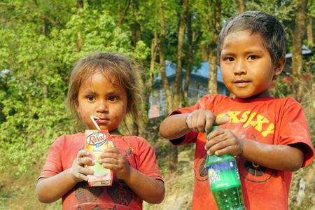 nepali: Pokhara, Nepal - April 24 2016: Nepali boy and girl playing on the road