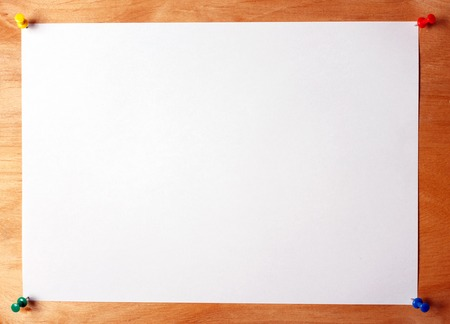 A sheet of paper attached to a wooden board with multicolored buttons