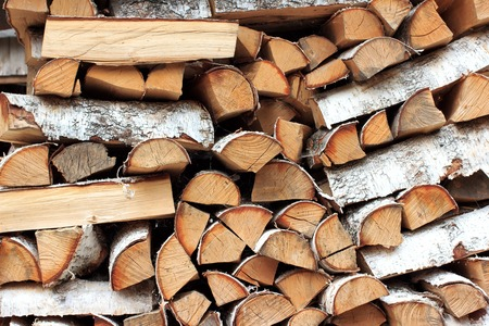 Background of dry chopped firewood logs in a pile Firewood