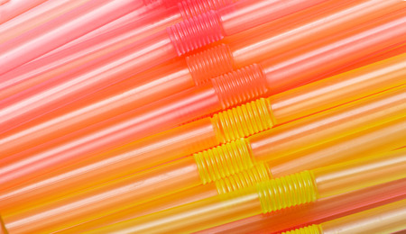Colorful plastic straws used for drinking soft drinks, juices, fresh, smoothies which are using in hotels, cafe and restaurants Banco de Imagens