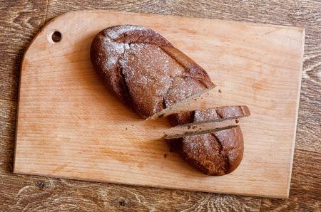 Sliced black bread on a chopping board