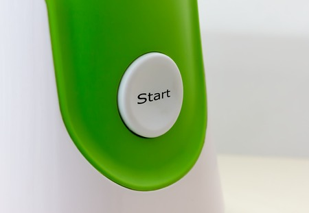 Start button on the white and green background