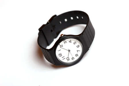 Classic black and white wrist watch on the white background