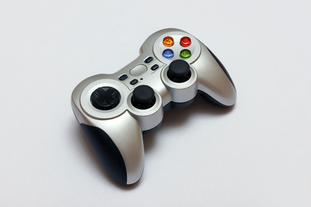 PC wireless game controller gamepad on a gray background Banco de Imagens