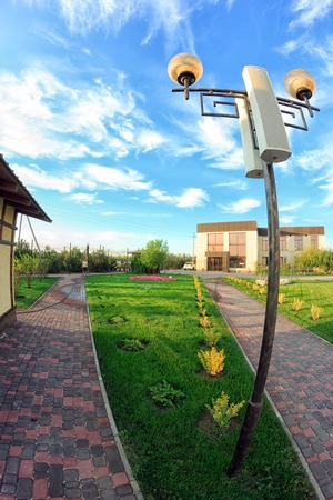 Kirillovka, Ukraine - August 28, 2016: Electric light pole with speakers in a beautiful green park Editorial