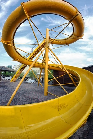 Yellow water slide close up shooting with fish eye lens