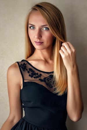 Vintage close up portrait of caucasian girl with beauty long hair in black dress