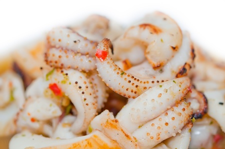 roasted squid with sauce on dish
